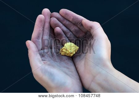 Young Homeless Boy Holds Big Gold Nugget