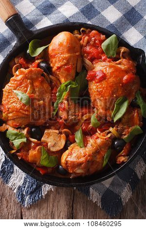 Cacciatori Chicken With Mushrooms Closeup In A Pan. Vertical Top View