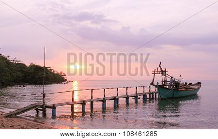 Silhouette Of Traditional Fishing Boat At Sunrise