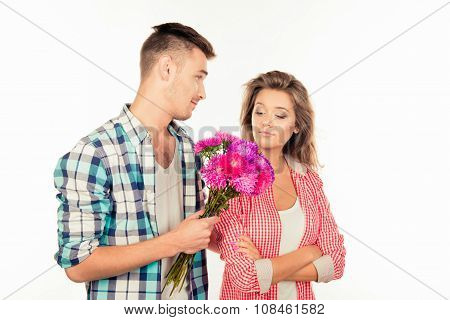 Handsome Young Man Giving A Bouquet To His Cute Beloved And Asking To Forgive Him