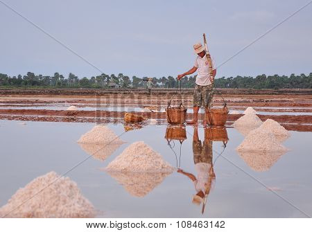 Vietnamese People Working On The Salt Fields
