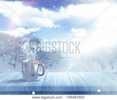 3D render of a Christmas mug on a wooden table against a defocussed snowy landscape
