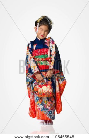 Young Girl In Kimono On White