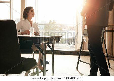 Female Executive At Conference Table During Presentation