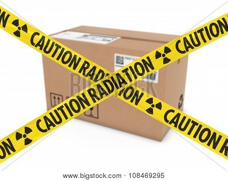 Radioactive Attack Parcel Concept - Cardboard Box Behind Caution Radiation Tape Cross