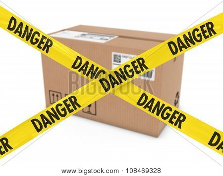 Suspicious Parcel Concept - Cardboard Box Behind Danger Tape Cross
