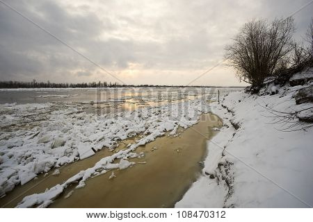 The beginning of winter in Ugra, ice on  river Ob.