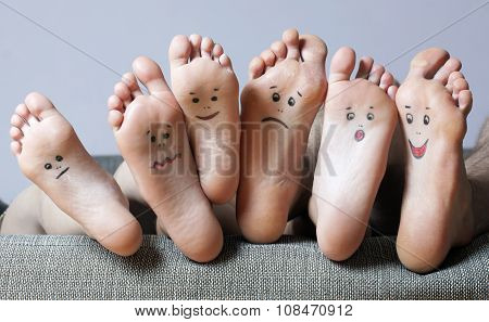 Human soles with painted faces.