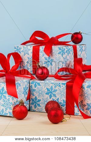 Gift In A Beautiful Package With A Red Ribbon On Blue Background
