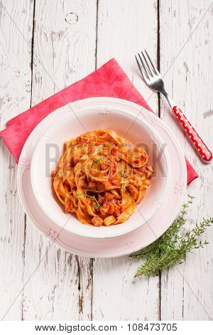 tagliatelle with ragout and thymus