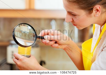 Woman Inspecting Food With Magnifying Glass.