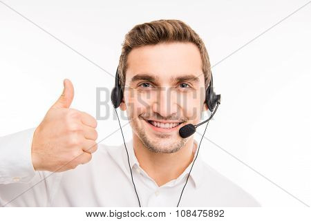 Young Agent Consulting Clients On The Phone Gesturing Thumb Up