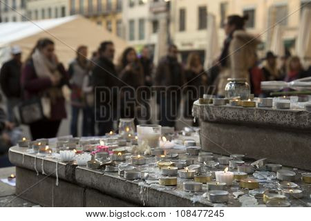 People praying and giving flowers and lighting candles on the steps of the town hall at Lyon, France about the terrorist bombing happens in France on 13th november
