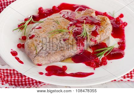Turkey Breast With Cranberry Sauce On A White Plate.