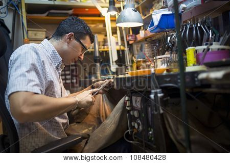 Jeweler Working