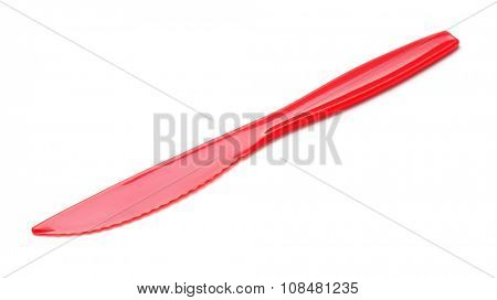 Red disposable picnic plastic knife isolated on white