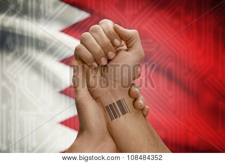 Barcode Id Number On Wrist Of Dark Skinned Person And National Flag On Background - Bahrain