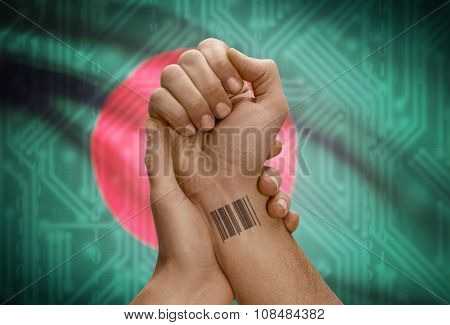 Barcode Id Number On Wrist Of Dark Skinned Person And National Flag On Background - Bangladesh