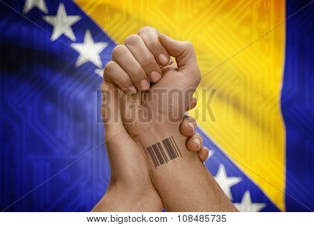 Barcode Id Number On Wrist Of Dark Skinned Person And National Flag On Background - Bosnia And Herze