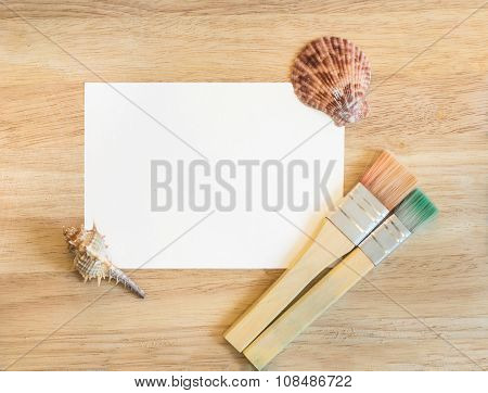 Beautiful sea composition with shells on wooden background. Summer frame with seashells, close-up. D