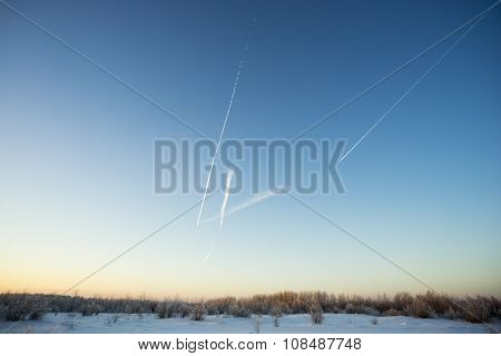 Traces of planes on the winter sky.