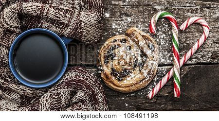 Mug of hot tea or coffee with scarf. Christmas decorations.