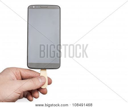 Man Holds In His Hand Mobile Phone On A Stick Like A Chocolate Popsicle On A White Background