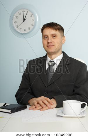 Young Chief Sitting On Workplace