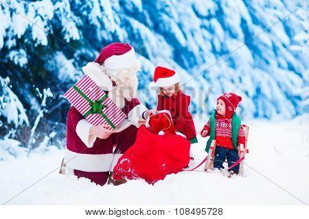 Kids And Santa With Christmas Presents