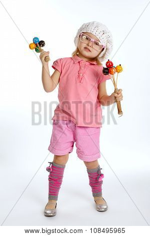 little beautiful girl with maracas