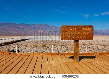 Sign Bad Water Basin and salt behind, Death Valley