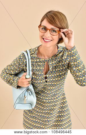 Vintage girl with eyeglasses and purse, isolated