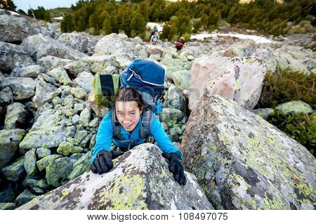 Young Woman Is Climbing At Stone Whike Trekking In Highlands Of Altai Mountains, Russia