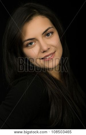 young beautiful brunette portrait against black background