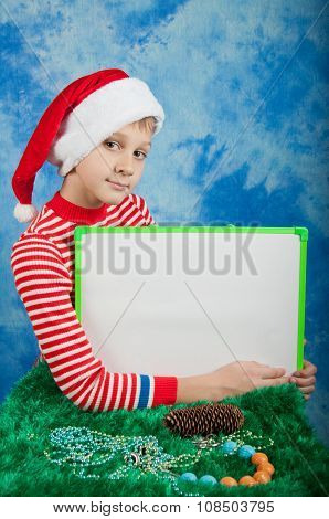 Boy In Christmas Costume Holding White Cardboard