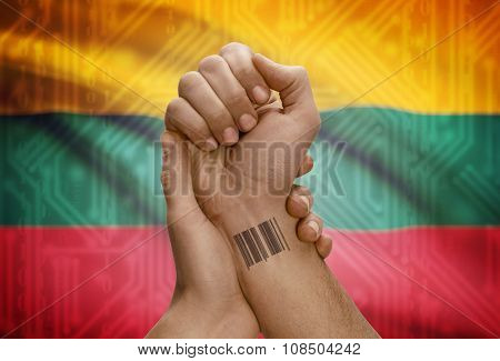 Barcode Id Number On Wrist Of Dark Skinned Person And National Flag On Background - Lithuania