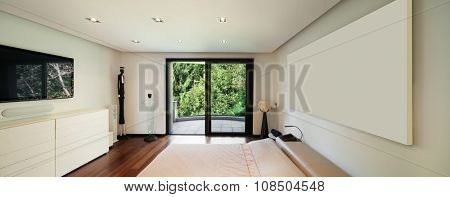 Interior of modern house, bedroom with balcony