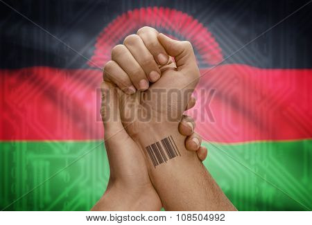 Barcode Id Number On Wrist Of Dark Skinned Person And National Flag On Background - Malawi