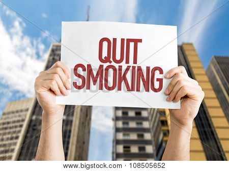 Quit Smoking placard with urban background