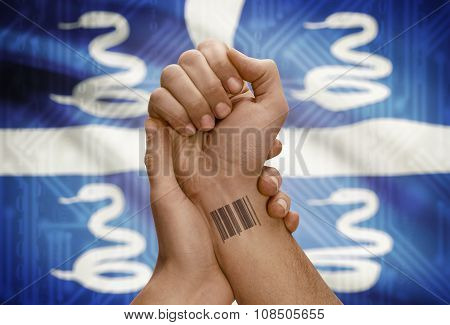 Barcode Id Number On Wrist Of Dark Skinned Person And National Flag On Background - Martinique