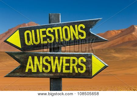 Questions Answers signpost in a desert background