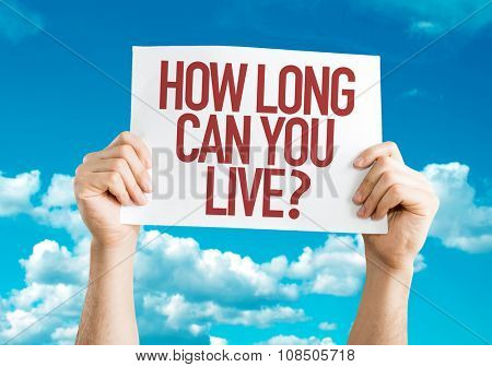 How Long Can You Live? placard with sky background