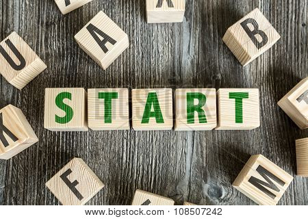 Wooden Blocks with the text: Start