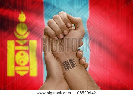Barcode Id Number On Wrist Of Dark Skinned Person And National Flag On Background - Mongolia