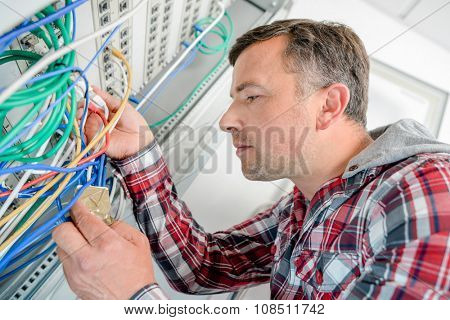 Computer technician checking the server