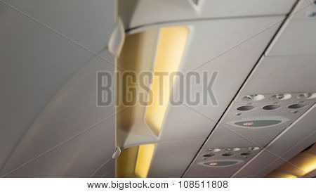 No smoking sign and seat belt sign on the airplane