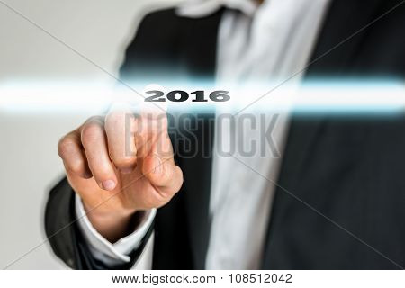 Closeup Of Male Finger Activating A 2016 Sign On A Virtual Screen