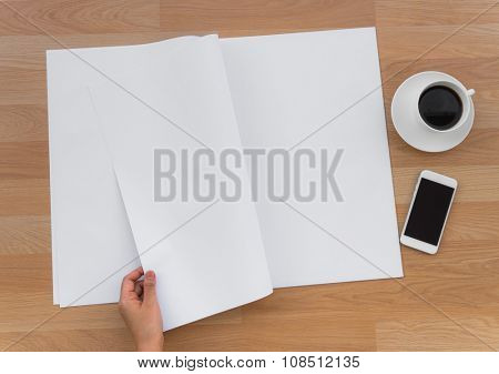 Hand hold Blank Newspaper with empty space mock up on wood background