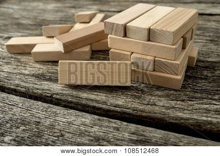 Blank Wooden Block Leaning On A Structure Made Of Many Other Blocks