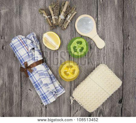 Set for spa handmade soap sponge lemon  towel mirror perfume grass on wooden background.